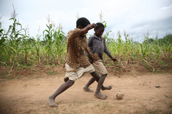 Boys play football in Khulungira, Malawi
